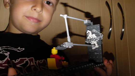 My son demonstrates his Lego® creativity by building some sort of weird torture device. Poor Lego® guy!